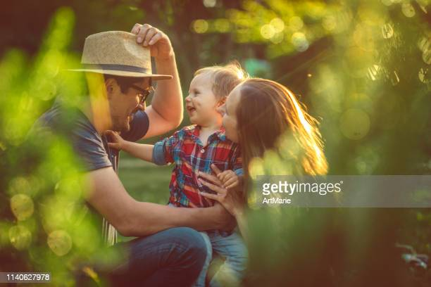 happy family in the park - public park stock pictures, royalty-free photos & images