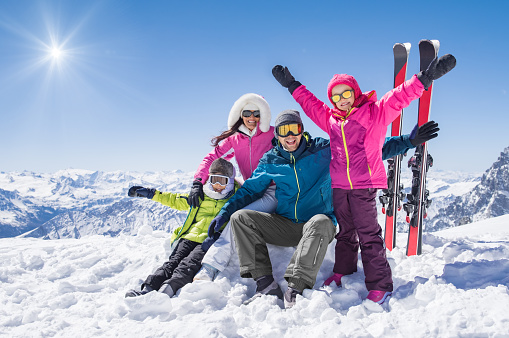 Happy family in winter holiday 831415524