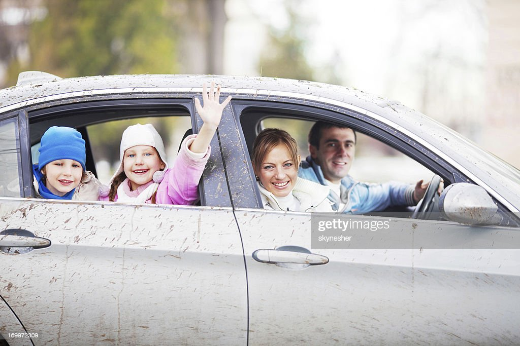 Happy family ina very dirty car. : Stock Photo