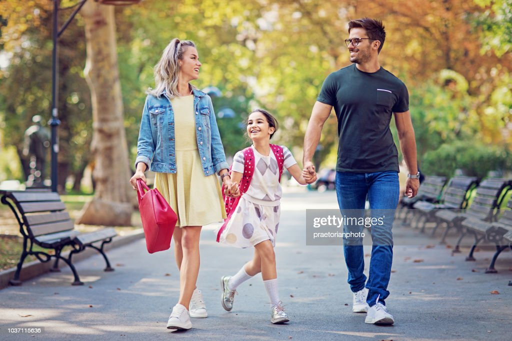 Happy family is going to the school together : Stock Photo