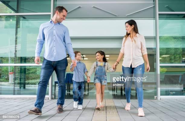 Happy family leaving the hospital