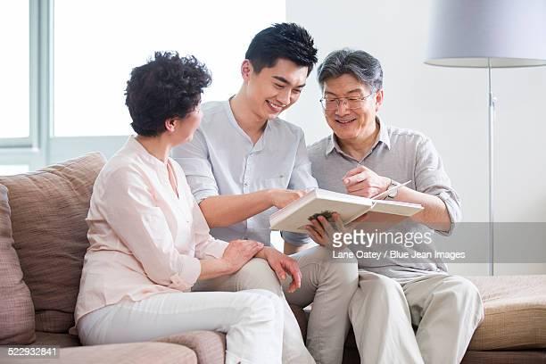 Happy family looking at photo album
