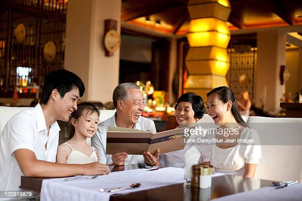 Happy family looking through a menu
