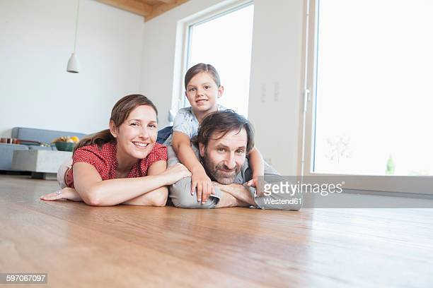 Happy family lying on floor, smiling
