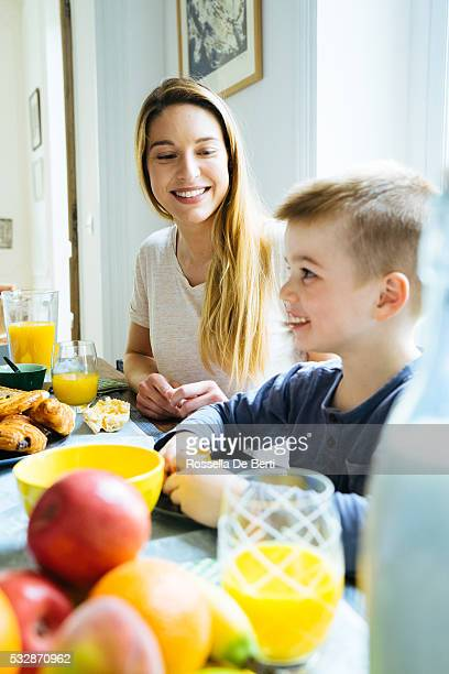 Happy Family, Mother And Son, Having Breakfast Together At Home