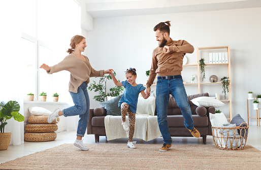 happy family mother father and child daughter dancing at home 1141507267