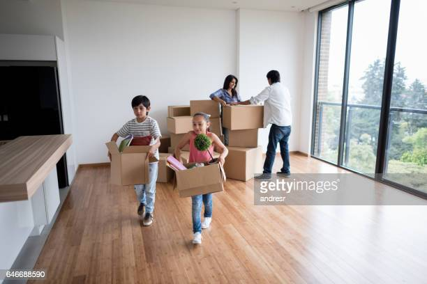 happy family moving home - unpacking stock pictures, royalty-free photos & images