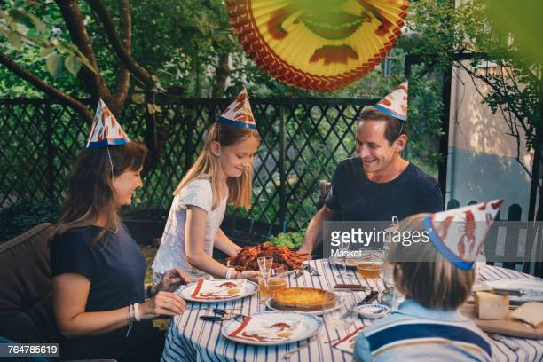 happy family of four enjoying crayfish party in yard - crayfish seafood stock pictures, royalty-free photos & images