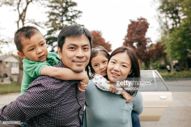 happy family of four - chinese ethnicity stock pictures, royalty-free photos & images
