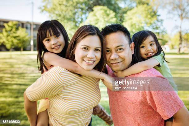 happy family of four - philippines family stock pictures, royalty-free photos & images