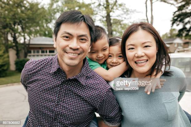 happy family of four - chinese family stock photos and pictures