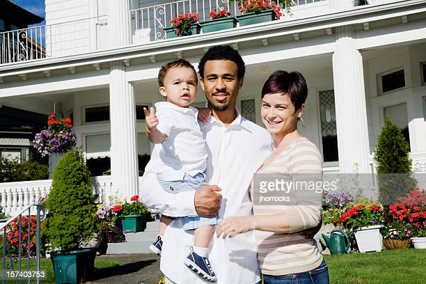 happy family of three at home - white wife black baby stock photos and pictures