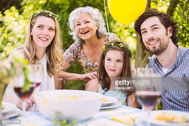 Happy family of three generations on a garden party