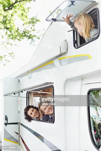 Happy family of three in a caravan