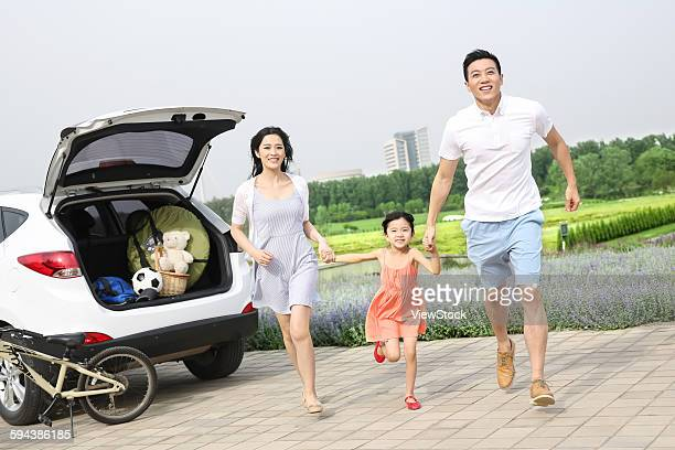 A happy family of three outdoor picnic