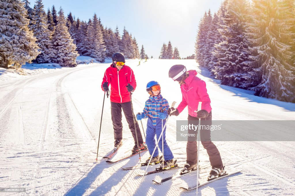 Happy family on a ski trip : Stock Photo