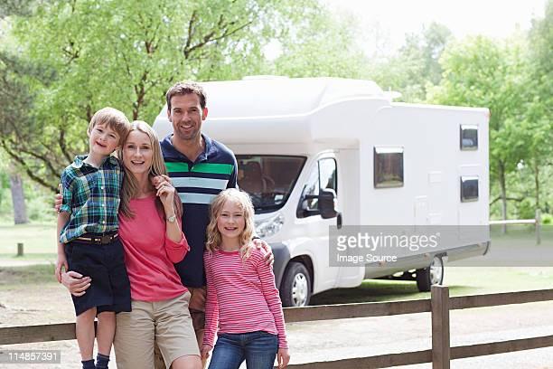Happy family on caravan holiday