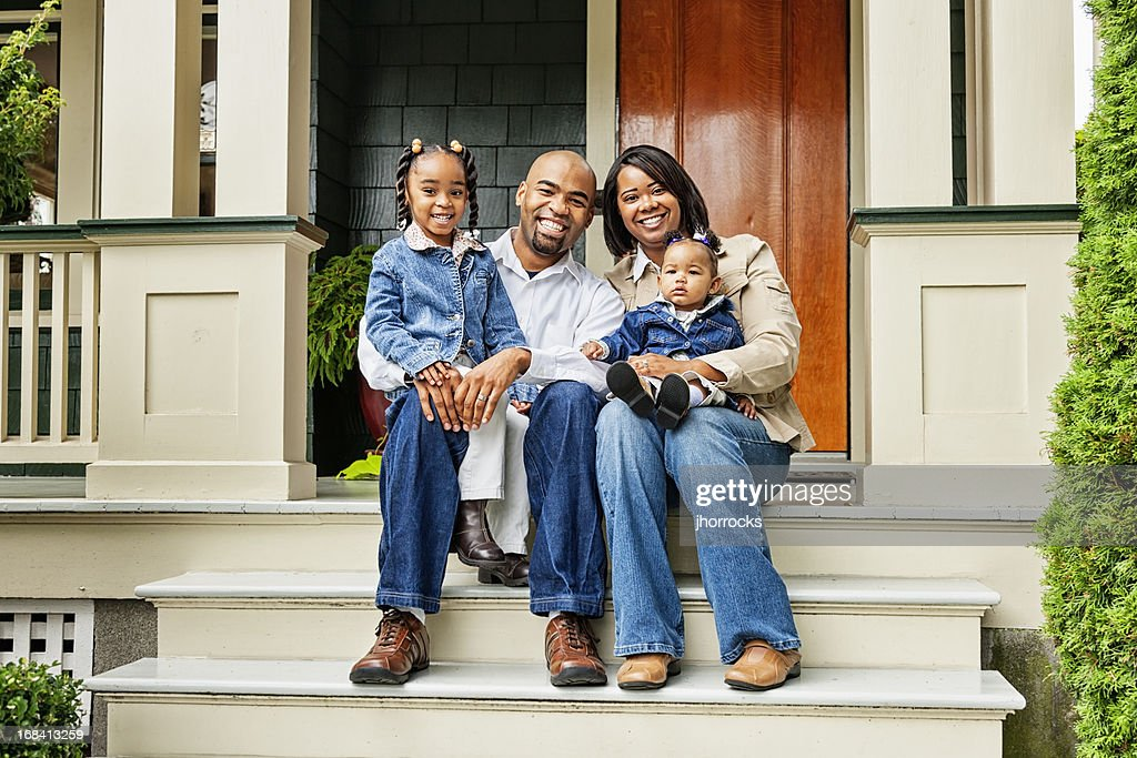 Happy Family on Front Porch : Stock Photo