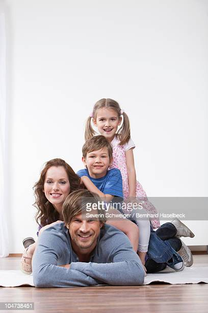 Happy family on rug