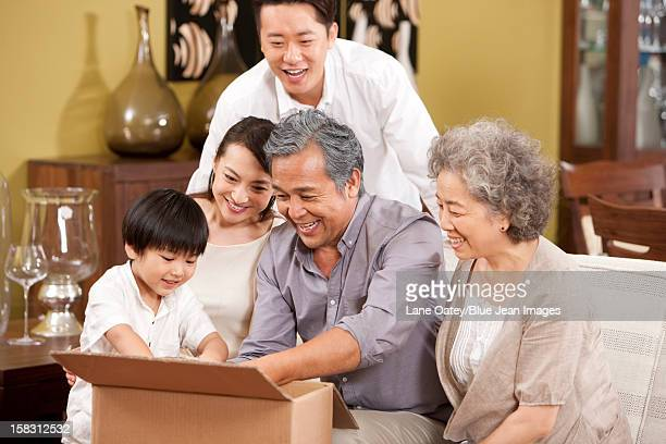 Happy family opening a carton