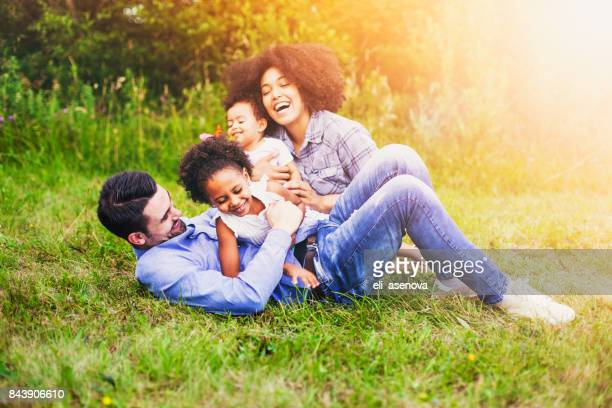 Happy family outdoor in the park.