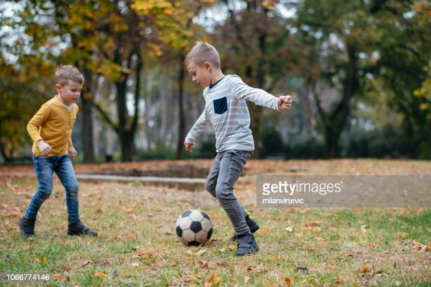 happy family outdoors having fun - football player stock pictures, royalty-free photos & images