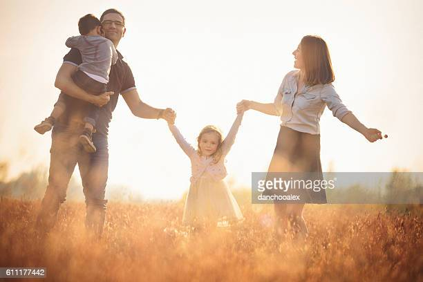 happy family outdoors having fun - hot mom stock photos and pictures