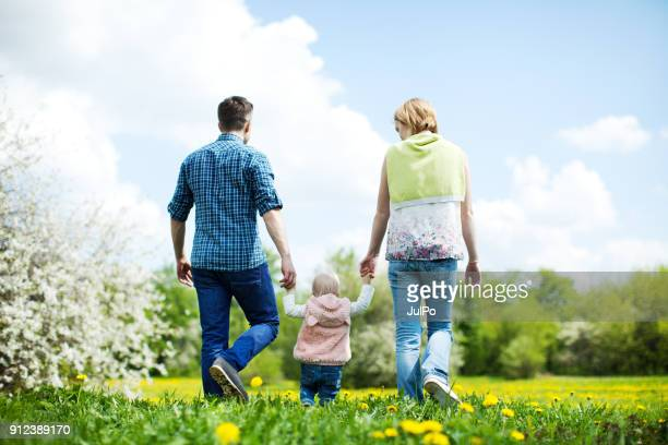 happy family outdoors - leaving stock pictures, royalty-free photos & images