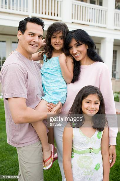 Happy family outside their house