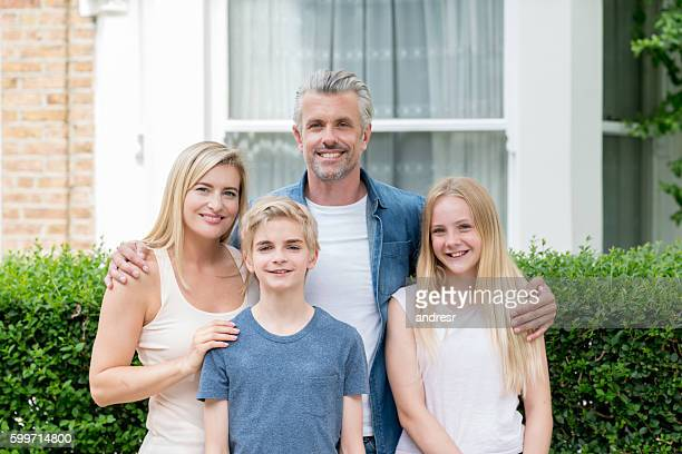 Happy family outside their new house