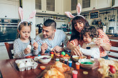 Happy family painting Easter eggs