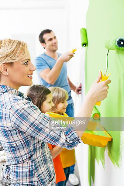 Happy family painting walls
