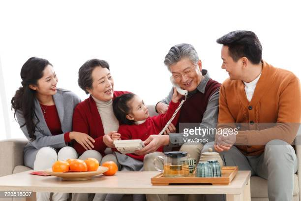 happy family phone pay new years call - 65 69 years stock pictures, royalty-free photos & images