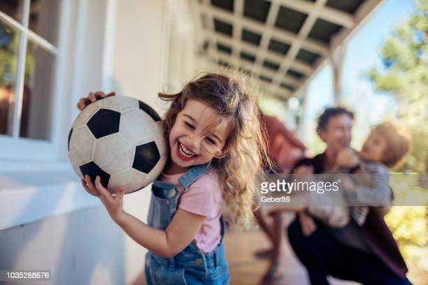 happy family - sports ball stock pictures, royalty-free photos & images