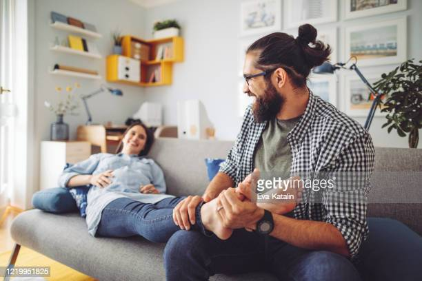 happy family - foot massage stock pictures, royalty-free photos & images