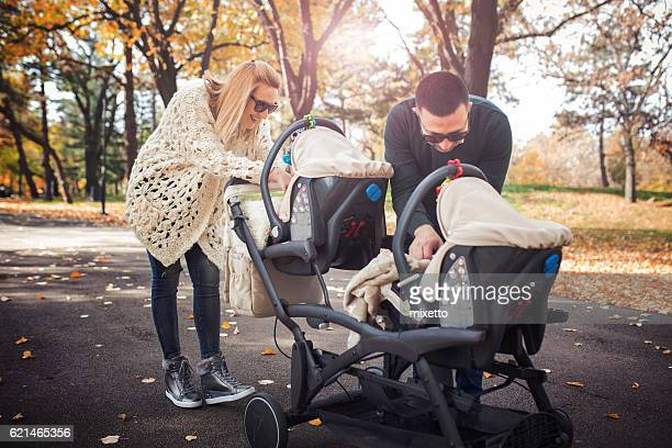 happy family - pushchair stock pictures, royalty-free photos & images