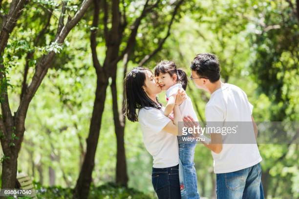 happy family - chinese family stock photos and pictures