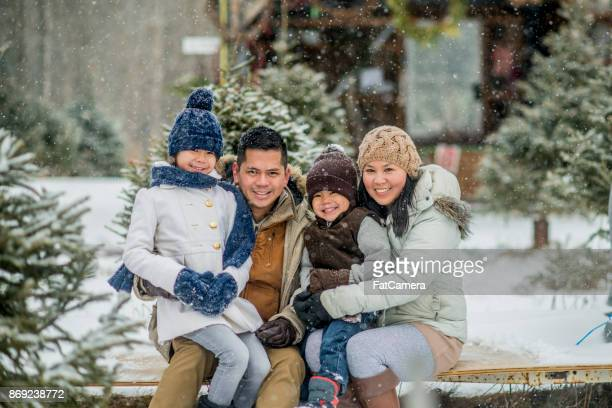 happy family - christmas tree farm stock pictures, royalty-free photos & images