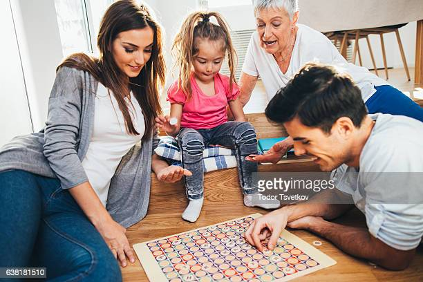 Happy family playing a game