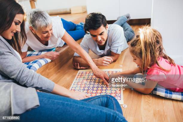 happy family playing a game - leisure games stock pictures, royalty-free photos & images