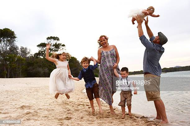 Happy Family Playing at the beach