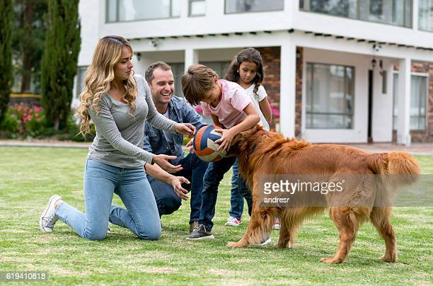 Happy family playing ball outdoors