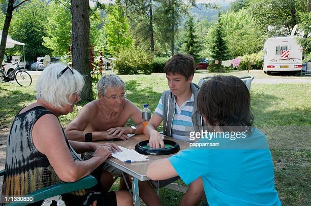 Happy Family playing dice on campsite 3