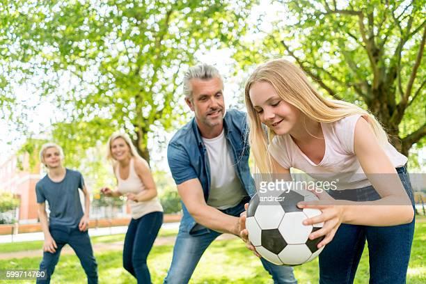 happy family playing football - mama futbol fotografías e imágenes de stock