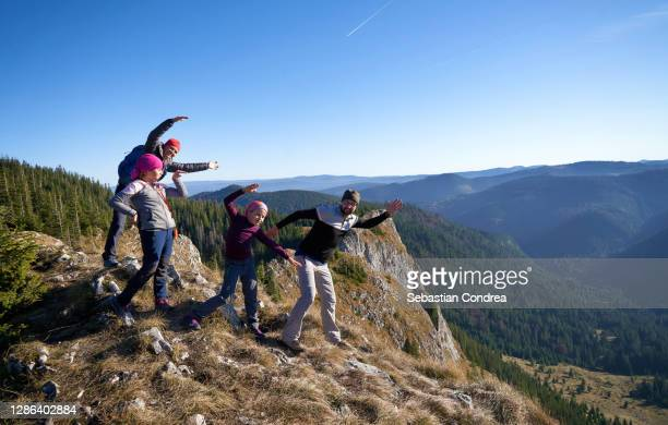happy family playing on the hiking trail road foothpath apuseni mountains, transylvania. - romania stock pictures, royalty-free photos & images