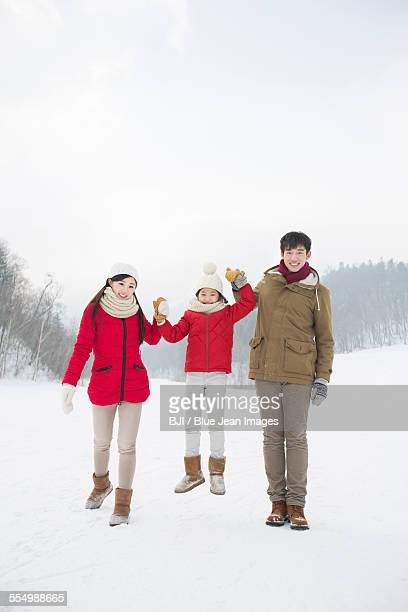 happy family playing on the snow - harbin winter stock pictures, royalty-free photos & images
