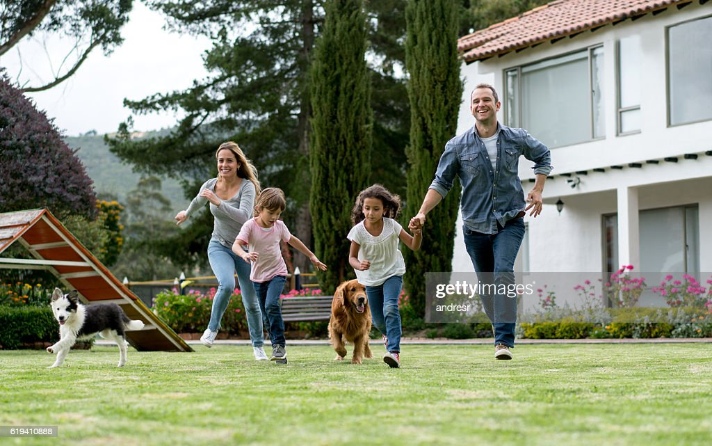 Happy family playing outdoors : Stock Photo