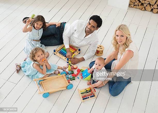 Happy Family Playing Together At Home