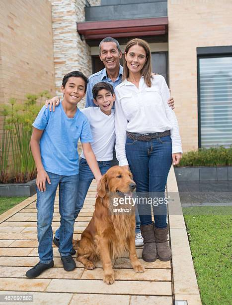 Happy family portrait outside their house