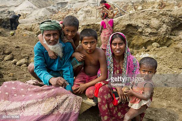 A happy family poses for the camera during a break at the stone extraction site in Jaflong Sylhet Bangladesh on February 28 2015 Sylhet is a very...